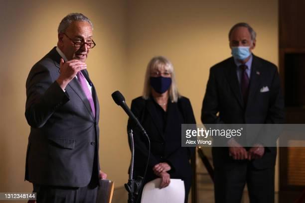Senate Majority Leader Sen. Chuck Schumer speaks as Sen. Patty Murray and Sen. Tom Carper listen during a news briefing after a weekly Senate...