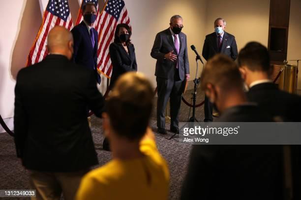 Senate Majority Leader Sen. Chuck Schumer speaks as Sen. Ron Wyden , Sen. Maria Cantwell and Sen. Tom Carper listen during a news briefing after a...