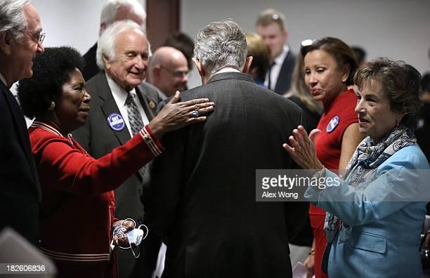 S Senate Majority Leader Sen Harry Reid arrives at a ceremony as he is welcomed by Sen Tom Harkin Rep Sheila JacksonLee Rep Sander Levin Rep Nydia...