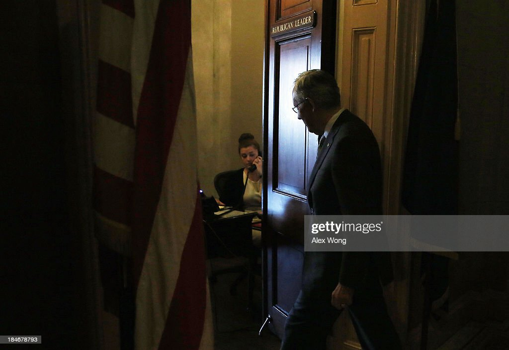 U.S. Senate Majority Leader Sen. Harry Reid (D-NV) enters the office of Minority Leader Sen. Mitch McConnell (R-KY) at the U.S. Capitol for a visit October 15, 2013 on Capitol Hill in Washington, DC. The U.S. government shutdown is entering its 15th day as the U.S. Senate and House of Representatives remain gridlocked on funding the federal government.