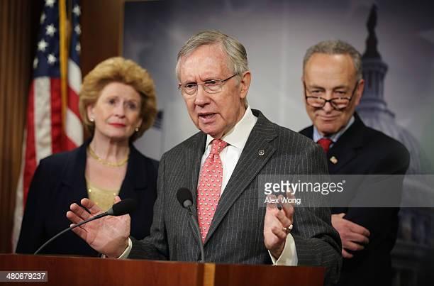 S Senate Majority Leader Sen Harry Reid speaks as Sen Debbie Stabenow and Sen Charles Schumer listen during a news conference March 26 2014 on...