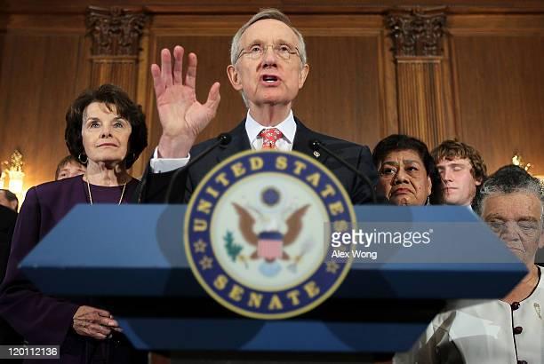 S Senate Majority Leader Sen Harry Reid speaks as Sen Dianne Feinstein listens during a news conference July 30 2011 on Capitol Hill in Washington DC...