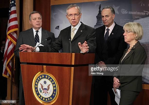S Senate Majority Leader Sen Harry Reid speaks as Senate Majority Whip Sen Richard Durbin Sen Charles Schumer and Sen Patty Murray listen during a...