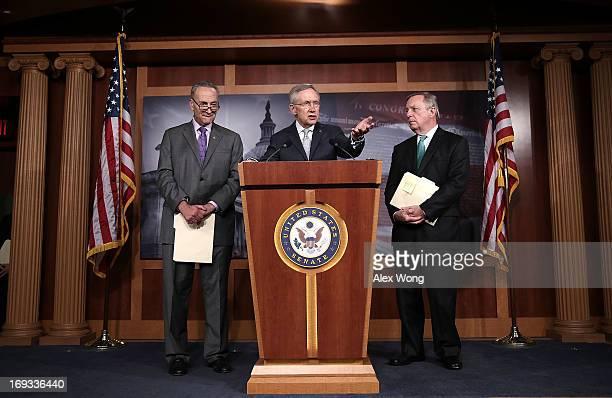 S Senate Majority Leader Sen Harry Reid speaks as Senate Majority Whip US Sen Richard Durbin and US Sen Charles Schumer listen during a news...