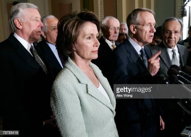 S Senate Majority Leader Sen Harry Reid speaks as Speaker of the House Rep Nancy Pelosi House Majority Leader Rep Steny Hoyer Rep Tom Lantos and...