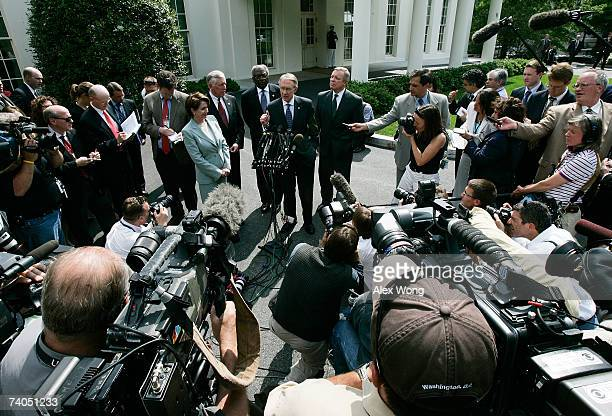S Senate Majority Leader Sen Harry Reid speaks as Speaker of the House Rep Nancy Pelosi House Majority Leader Rep Steny Hoyer House Majority Whip Rep...
