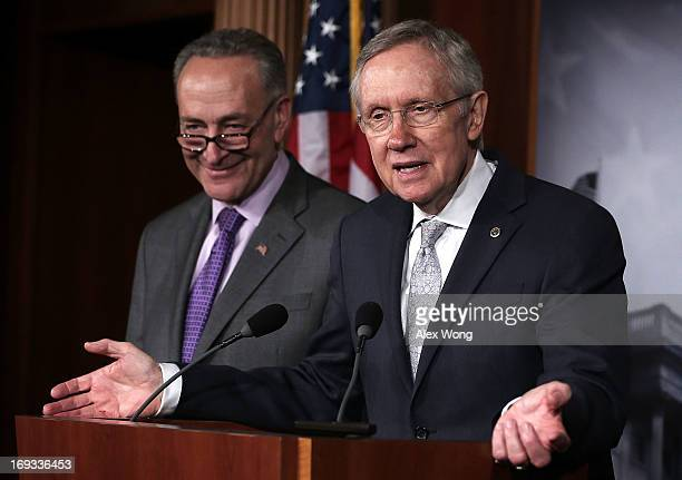 S Senate Majority Leader Sen Harry Reid speaks as US Sen Charles Schumer listens during a news conference May 23 2013 on Capitol Hill in Washington...