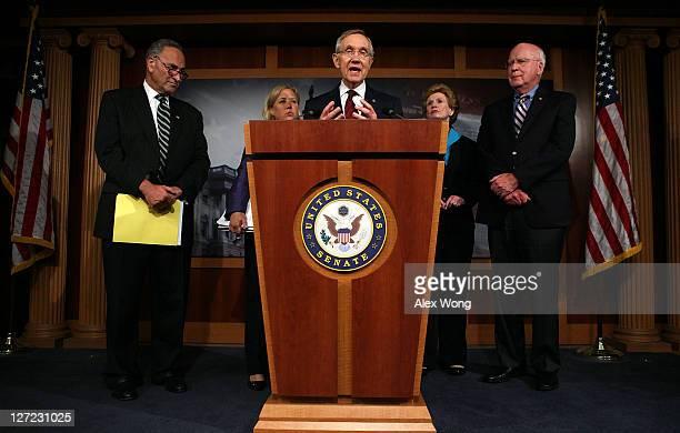 S Senate Majority Leader Sen Harry Reid speaks as US Sen Charles Schumer US Sen Mary Landrieu US Sen Debbie Stabenow and US Sen Patrick Leahy listen...