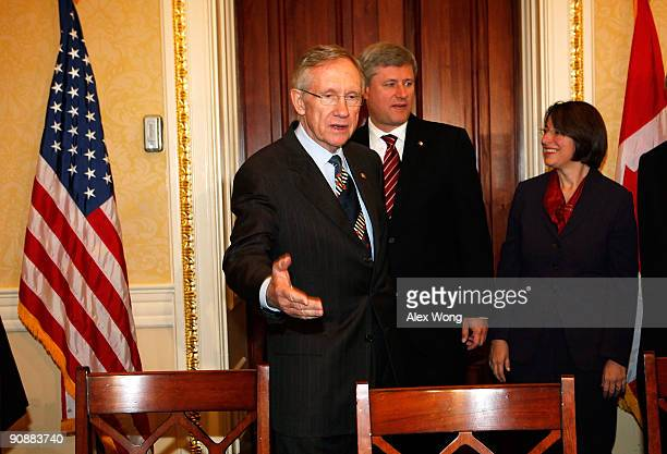Senate Majority Leader Sen. Harry Reid welcomes Canadian Prime Minister Stephen Harper as Sen. Amy Klobuchar looks on during a meeting September 17,...