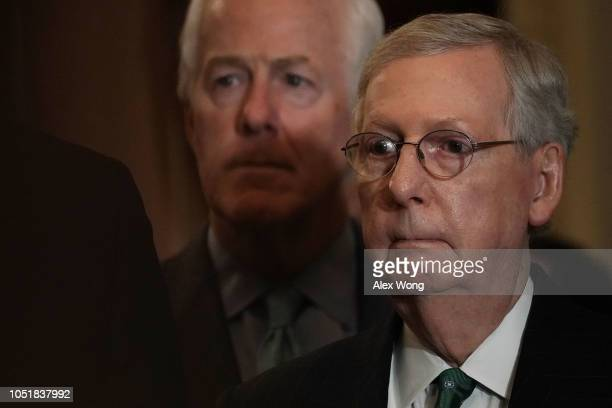 S Senate Majority Leader Sen Mitch McConnell and Senate Majority Whip Sen John Cornyn listen during a news briefing after a weekly Senate Republican...