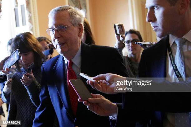 S Senate Majority Leader Sen Mitch McConnell is chased by members of the media as he walks from the Senate chamber to his office December 1 2017 at...