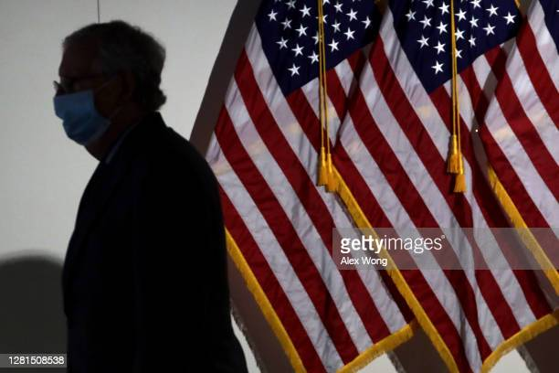 Senate Majority Leader Sen. Mitch McConnell leaves after a luncheon at Hart Senate Office Building October 21, 2020 on Capitol Hill in Washington,...