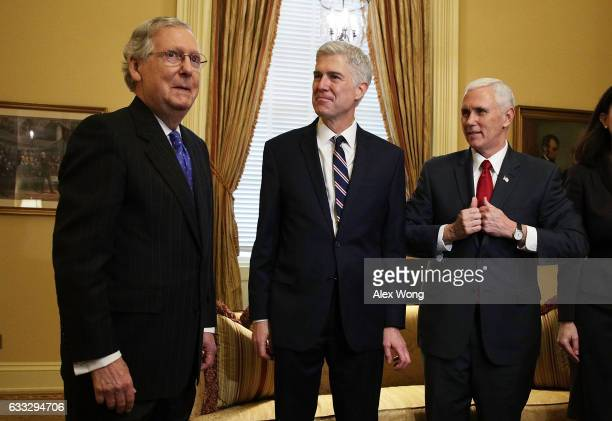 S Senate Majority Leader Sen Mitch McConnell meets with Supreme Court nominee Judge Neil Gorsuch and Vice President Mike Pence February 1 2017 at the...