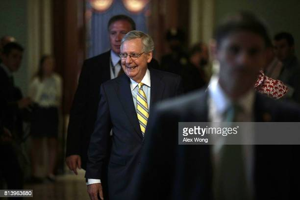 S Senate Majority Leader Sen Mitch McConnell on his way to his office July 13 2017 at the Capitol in Washington DC McConnell has releaseed a new...