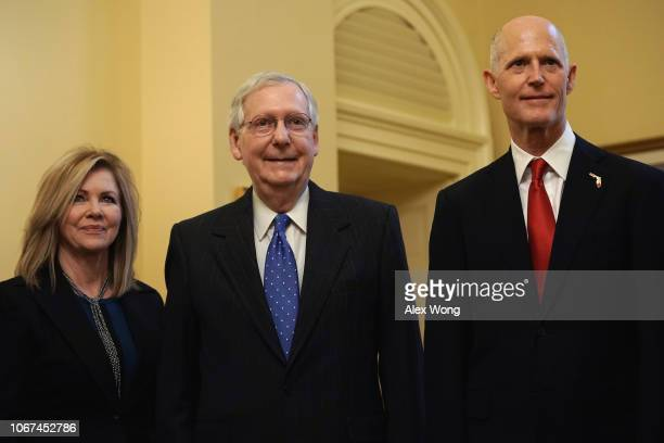 S Senate Majority Leader Sen Mitch McConnell poses for photos with Senatorelect Marsha Blackburn and Republican US Senate candidate for Florida and...