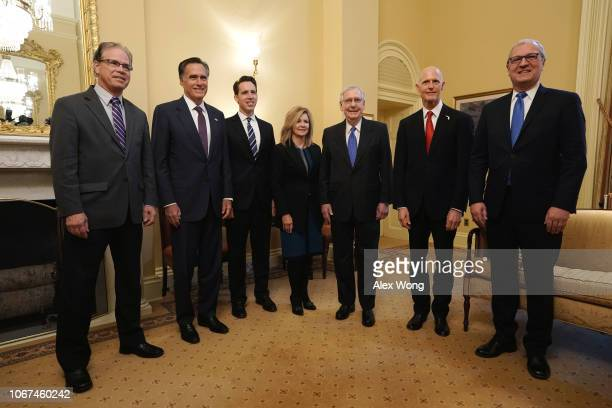 S Senate Majority Leader Sen Mitch McConnell poses for photos with Senatorelects Mike Braun Mitt Romney Josh Hawley Marsha Blackburn Kevin Cramer and...
