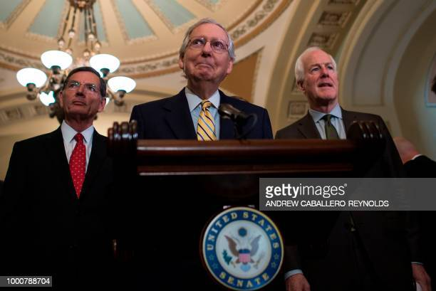 S Senate Majority Leader Sen Mitch McConnell speaks as Sen John Thune and Senate Majority Whip Sen John Cornyn listen during a news briefing after a...