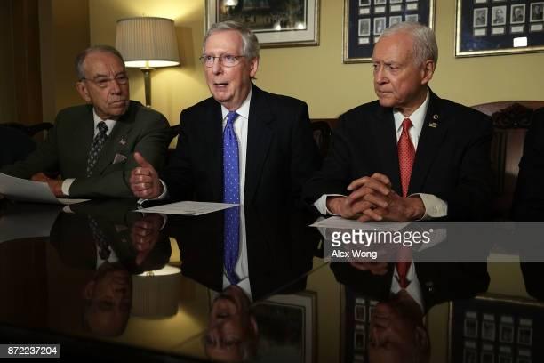 S Senate Majority Leader Sen Mitch McConnell speaks as Senate Finance Committee Chairman Sen Orrin Hatch and Sen Chuck Grassley listen during a...