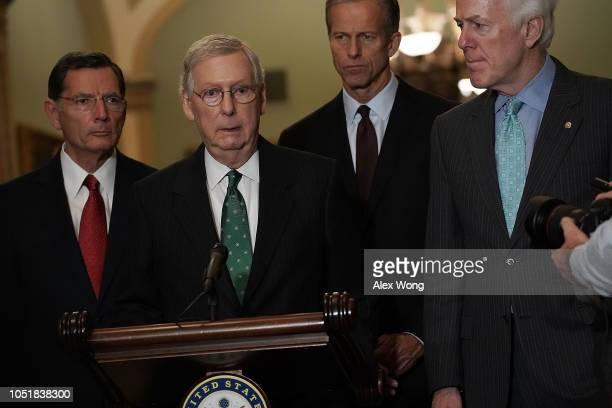 S Senate Majority Leader Sen Mitch McConnell speaks as Senate Majority Whip Sen John Cornyn Sen John Barrasso and Sen John Thune listen during a news...