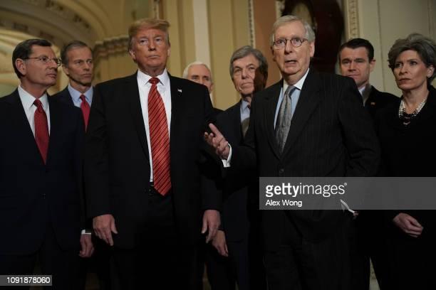 S Senate Majority Leader Sen Mitch McConnell speaks to members of the media as Sen John Barrasso Sen John Thune President Donald Trump Vice President...