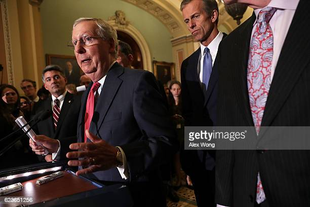Senate Majority Leader Sen Mitch McConnell speaks to members of the media flanked by Sen Cory Gardner and Sen John Thune during a news briefing after...