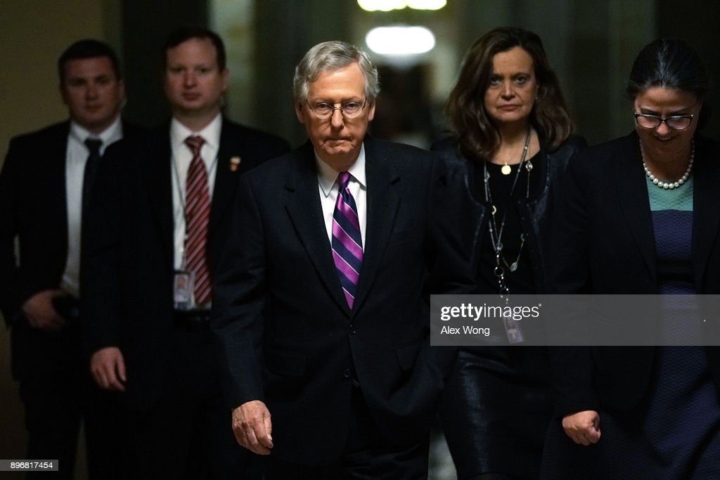 U.S. Senate Majority Leader Sen. Mitch McConnell (R-KY) (C) walks towards the Senate chamber with aides after the House passed a bill to temporary fund the government through January 19 and averted a shutdown December 21, 2017 at the Capitol in Washington, DC. The Senate is expected to vote on the bill soon.