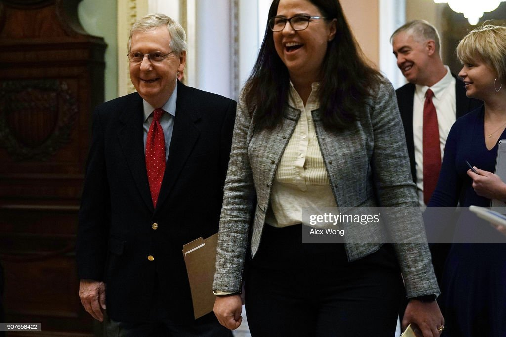 U.S. Senate Majority Leader Sen. Mitch McConnell (R-KY) (L) walks towards the Senate chamber January 20, 2018 at the U.S. Capitol in Washington, DC. The U.S. government is shut down after the Senate failed to pass a resolution to temporarily fund the government through February 16.