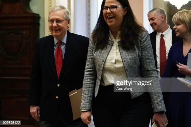 S Senate Majority Leader Sen Mitch McConnell walks towards the Senate chamber January 20 2018 at the US Capitol in Washington DC The US government is...