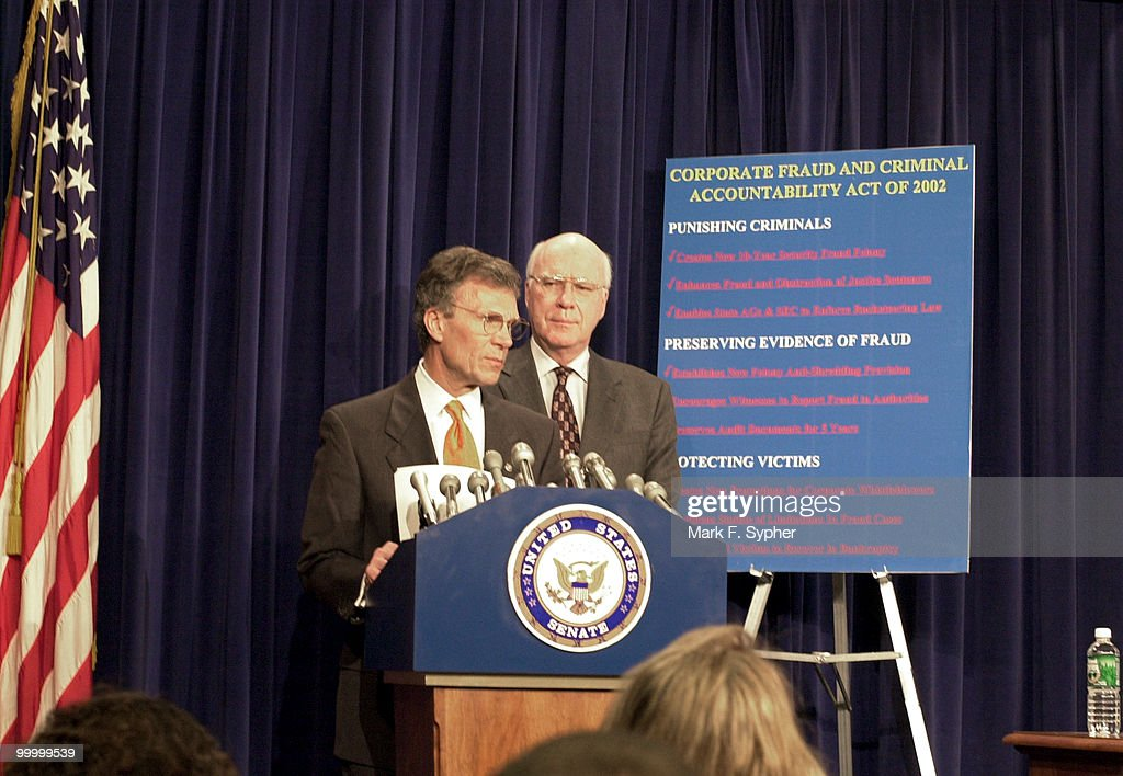 Senate Majority Leader Tom Daschle (D-SD) and Sen. Patrick Leahy (D-VT) at a news conference on securities fraud in the Senate Radio and TV Gallery.