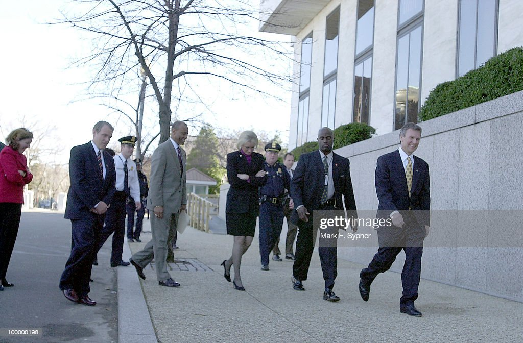 Senate Majority Leader Tom Daschle, right, walks down C street NE to re-open the Hart Senate Office Building, which was closed more than three months ago when an anthrax tainted letter was opened by one of his staff, infecting more than 20 people.