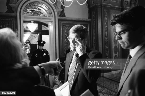 Senate Majority Leader Trent Lott speaks with reporters in the halls the US Capitol Building on the first day of the Senate Impeachment Trial of...