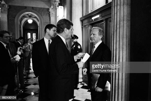 Senate Majority Leader Trent Lott speaks with Sen Joe Lieberman of Connecticut in the hallway of the US Capitol Building the day before the start of...