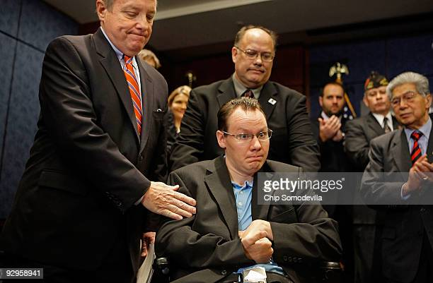 Senate Majority Whip Dick Durbin thanks US Army Specialist Eric Edmondson and his father Ed Edmondson during a news conference about Democratic...