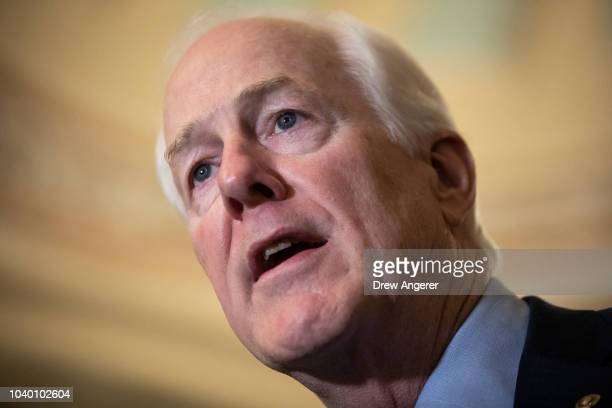 Senate Majority Whip John Cornyn addresses reporters following the weekly GOP policy luncheon on Capitol Hill September 25 2018 in Washington DC...