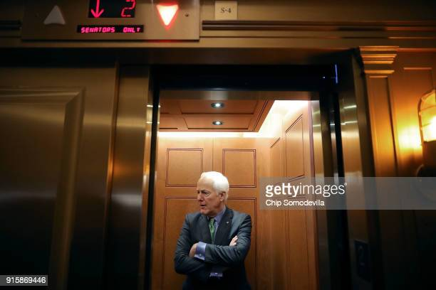Senate Majority Whip John Cornyn boards an elevator following a Republican caucus luncheon at the US Capitol February 8 2018 in Washington DC Senate...