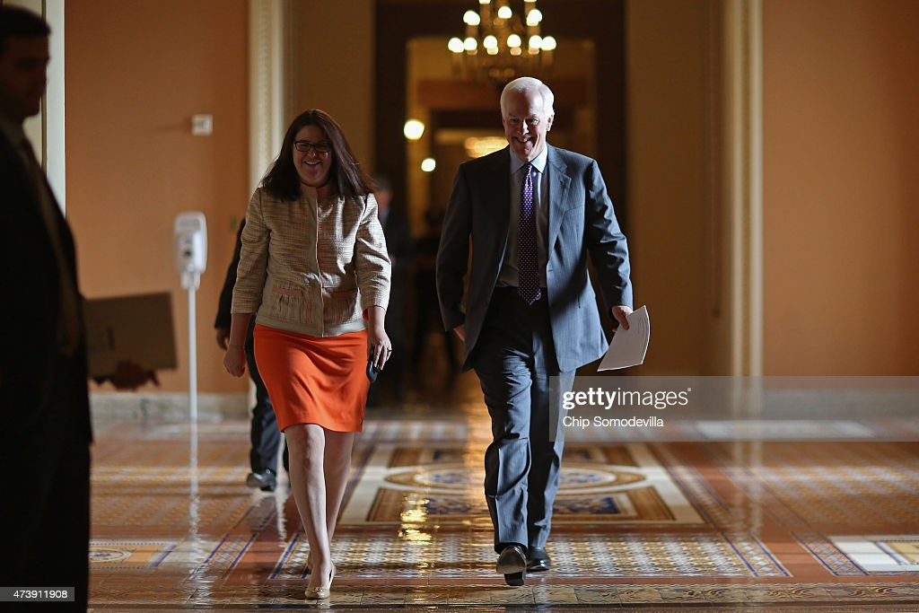 Senate Majority Whip John Cornyn (R-TX) (R) heads to the Senate floor at the U.S. Capitol May 18, 2015 in Washington, DC. Senate Majority Leader Mitch McConnell (R-KY) said that he will postpone the Senate's Memorial Day recess until lawmakers tackle a trade bill, renewal of the Patriot Act and funding for federal highways.