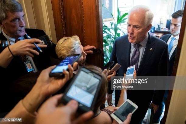 Senate Majority Whip John Cornyn speaks to reporters outside his office before the weekly GOP policy luncheon on Capitol Hill September 25 2018 in...