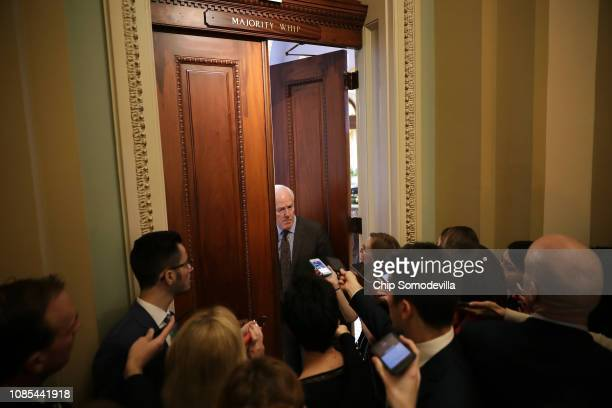 Senate Majority Whip John Cornyn talks to reporters as he backs into his office at the US Capitol December 21 2018 in Washington DC The US Senate is...