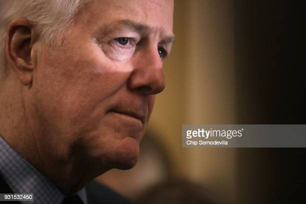 Senate Majority Whip John Cornyn talks to reporters following the regular Republican policy luncheon at the US Capitol March 13 2018 in Washington DC...