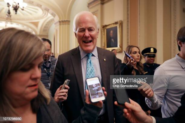 Senate Majority Whip John Cornyn talks with reporters before heading into the weekly Senate Republican policy luncheon in the US Capitol November 27...