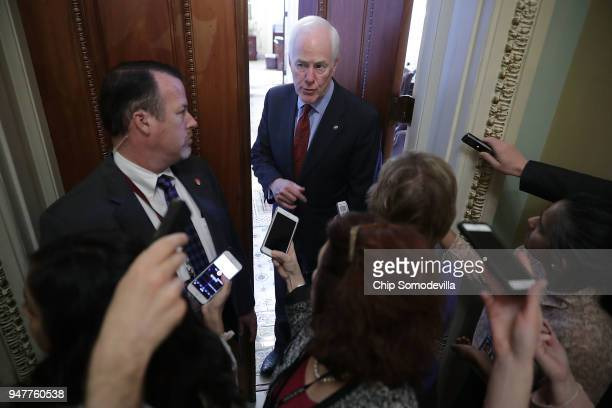 Senate Majority Whip John Cornyn talks with reporters before stepping back into his office at the US Capitol April 17 2018 in Washington DC Vice...