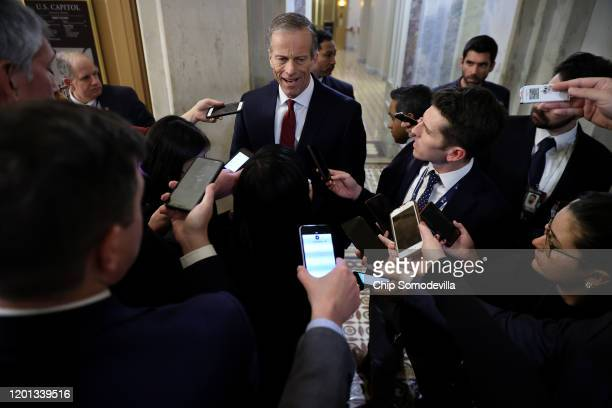 Senate Majority Whip John Thune talks to reporters on his way out of the U.S. Capitol at the conclusion of the second day of President Donald Trump's...