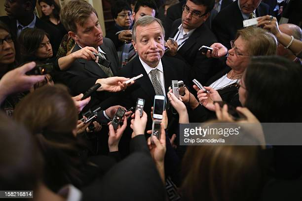Senate Majority Whip Richard Durbin talks to reporters after the Senate Democrats' weekly policy luncheon at the US Capitol December 11 2012 in...