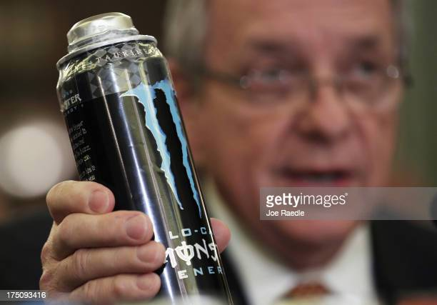 S Senate Majority Whip Sen Richard Durbin holds up a can of Monster energy drink as he testifies during a hearing before the Senate Commerce Science...