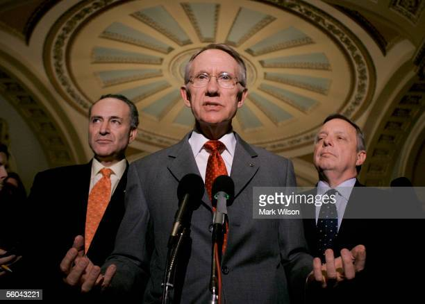 S Senate Miniority Leader Harry Reid flanked by US Sen Charles Schumer and US Sen Dick Durbin speaks to reporters outside of the Senate Chamber at...