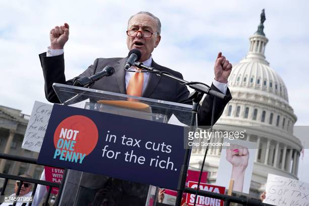 Senate Minority Leader Charles Schumer addresses a rally against the proposed Republican tax reform legislation on the east side of the US Capitol...