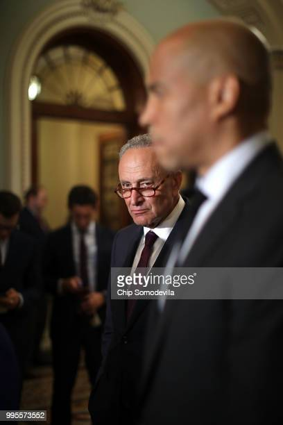 Senate Minority Leader Charles Schumer and Sen Cory Booker talk with reporters following the weekly Democratic policy luncheon meeting at the US...