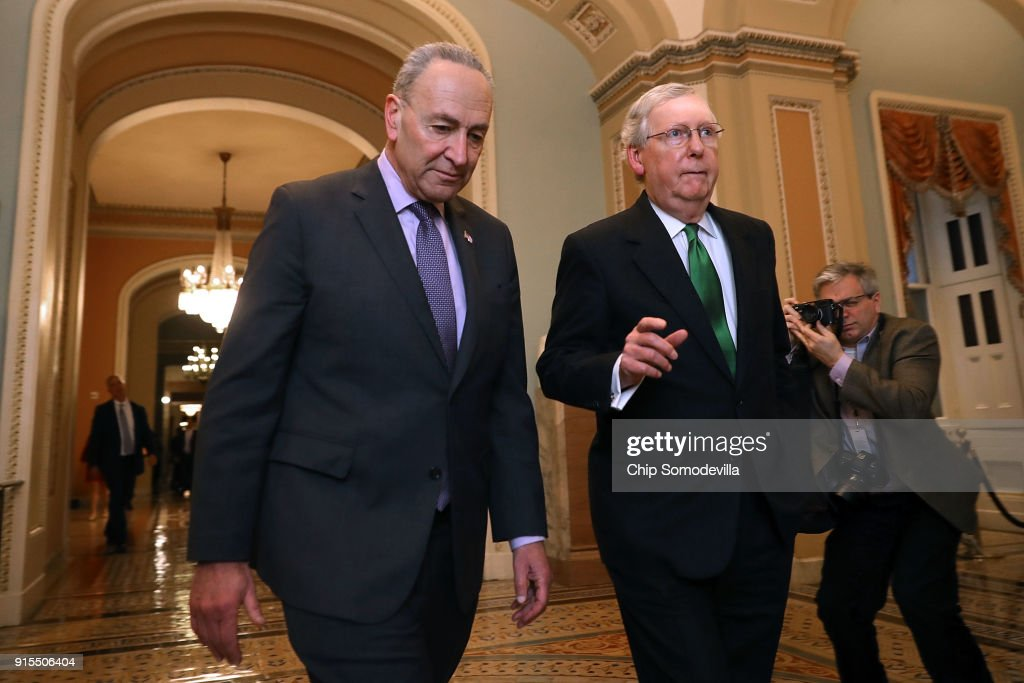 Senate Minority Leader Charles Schumer (D-NY) (L) and Senate Majority Leader Mitch McConnell (R-KY) walk side-by-side to the Senate Chamber at the U.S. Capitol February 7, 2018 in Washington, DC. The two leaders announced they had reached agreement on a 2-year budget deal that will raise strict caps on military and domestic spending.