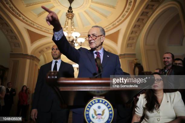 Senate Minority Leader Charles Schumer calls on reporters during a news conference with Sen Cory Booker and Sen Tammy Duckworth following the weekly...