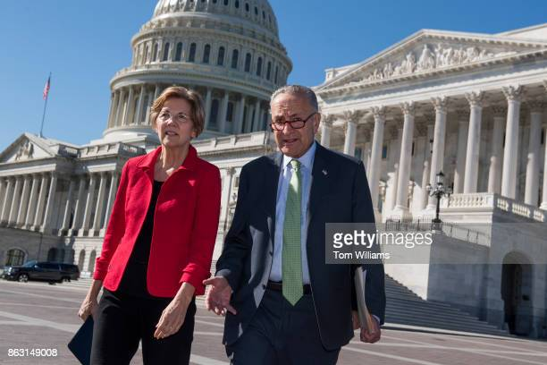 Senate Minority Leader Charles Schumer DNY and Sen Elizabeth Warren DMass make their way to a news conference on the east lawn of the Capitol on a...